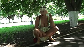 Sexy blonde flashing and hot masturbating in a public park.