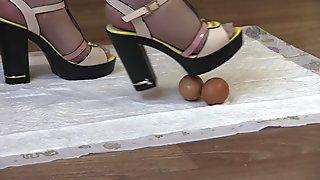crashes eggs with high heels, mature lady in high-heeled shoes